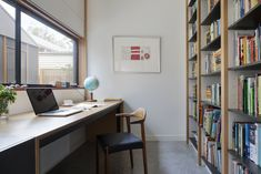 A Family Home in Australia Features a Playful Version of the Classic Pitched Roof - Photo 7 of 9 - One homeowner is studying part-time and requested a quiet workspace. The desk is made out of plywood and licorice linea from Laminex.