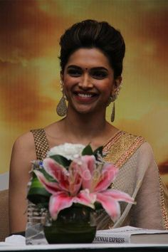 Deepika Padukone in a nude saree with droplet earrings