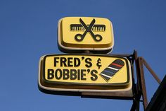 Fred's & Bobbie's Barber Shop, 14331 W. McNichols Road, Detroit, Michigan. As of mid-2017 pretty much every other neighboring business has closed and their windows barred & boarded up, but this sign's still up and the shop is still open with Fred Morris still cutting hair.