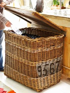 Hide your recycling containers with an old wicker laundry basket.  Now, just where to find a basket like this, any ideas?