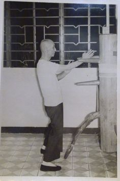 Wing Chun Grandmaster Ip Man practicing on a wooden dummy in 1967.7