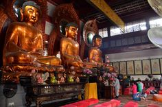 Chinese prayer rituals - Buddhism/ Taoism. Chinese people pray in temples for Buddhas. Bowing, chanting, lighting incense, altar offerings, meditation