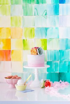 DIY Watercolor Paper Squares Backdrop would make a stunning addition to a cake table!