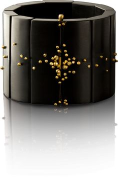 Jacquline Cullen: hand carved Whitby jet cuff with 18kt gold granulation and champagne diamonds