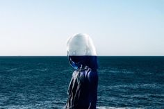 Translucent Figurative Sculpture Blends Into Horizon As Metaphor About Climate Change - My Modern Met
