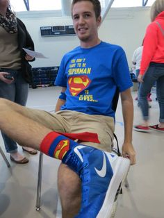 Vince Harris, a junior who made his 3rd lifetime dontion at the fall blood drive, wears super socks to go with his Superman tee.