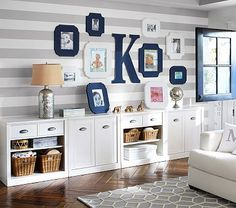 Grey & white striped walls for Liam's big boy bedroom. Accessorized with Pottery Barn Sawyer Storage and interesting frames.