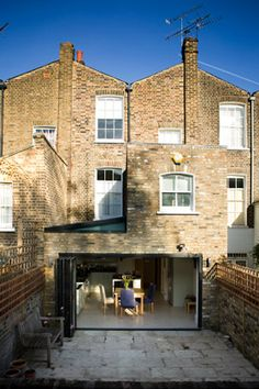 Like the traditional London brick for the extension, but want a contemporary look for the doors. Aim to have traditional front to the house with a slick/modern are at the rear.