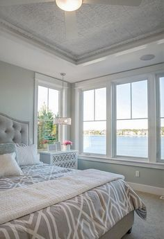 Love this pressed tin ceiling. Neutral beach house master bedroom. CVI Design