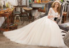 Morilee by Madeline Gardner 'Maira' 8110   Long Sleeve Wedding Dress Featuring Delicate Crystal Beading on Bodice and Embroidered AppliquéŽs on Tulle. V-Neckline and Open Keyhole Back. Colors Available: White, Ivory, Ivory/Caramel. Shown in Ivory/Caramel.