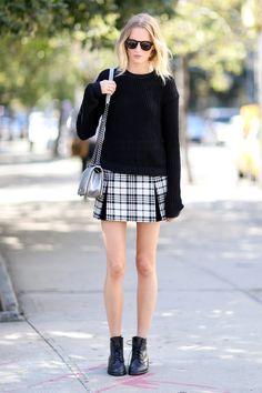 New York Fashion Week: A plaid miniskirt and sweater combo is the epitome of classic, '90s-inspired September dressing.