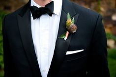 Lovely grooms boutonniere and black tie suit.  #wedding #groom #boutonniere