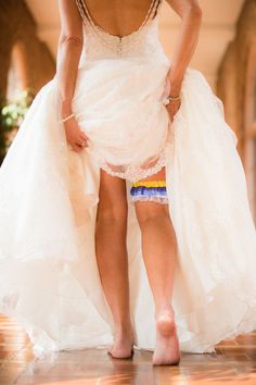 The garter is about to come off, and so the party begins. Colorful garter to throw to the crowd! Wedding day. Photo by Dempag Photography. (scheduled via http://www.tailwindapp.com?utm_source=pinterest&utm_medium=twpin)