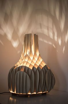 Soft Glow Cast by Original Plywood Lighting Unit from Mariam Ayvazyan - http://freshome.com/soft-glow-cast-by-unconventional-lighting-unit-mariam-ayvazyan/