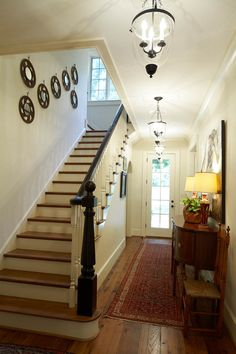 Stairs with painted pickets and stained handrail: PRITCHETT + DIXON