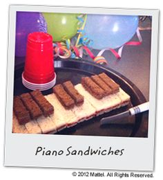 Create Piano Sandwiches using white and brown bread with crusts removed. Fill the sandwiches with peanut butter and jelly, cut into thin rectangles and line up alternating brown and white rectangles to resemble piano keys.