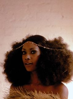 1970's She rocks rough and tough in her afro puffs!