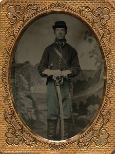 A pristine quarter plate tintype of a young Federal cavalryman. Sporting his cavalry jacket, gauntlets and a cap that looks to be a couple sizes to big for him.Very nice tinting to this one with his trousers and neck tie tinted with subtle shades of light blue. He is triple armed with a heavy cavalry saber, a small Root revolver and coffin handled Sheffield side knife. (Continued in comments.)