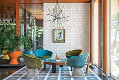 "Mixing California craft with the colors of the '70s resulted in a house that Adler claims is ""supermacrame"" yet ""done through a trippy contemporary lens."" The coffee table, rug, planters, and stool were all designed by Adler,  and the drawings by Eva Hesse inspired the ceramic tile wall.  Photo by Floto + Warner via Dwell Magazine"