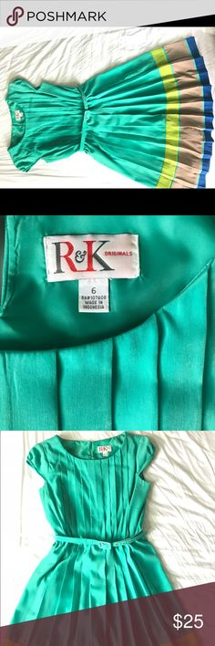 R & K originals pleated dress Beautiful pleated dress in shades of turquoise, bright royal blue and lime green. Very gently worn. Belted at the elastic waist. Button at the back of the neck. Dresses