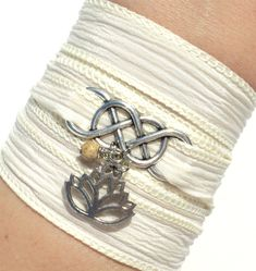 This listing is for one Infinity silk wrap bracelet. It can also be used as a necklace or anklet. It features a hand dyed cream silk ribbon, Ribbon Jewelry, Jewelry Crafts, Jewelry Ideas, Silk Wrap Bracelets, Charm Bracelets, Wrist Tattoo Cover Up, Etsy Free Shipping, Swarovski, Namaste