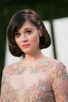 Look at the detail on Zoe Deschanel's dress. Its a pretty spectacular dress which shows true style and taste. |The Oscars 2013 Best Dressed|