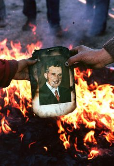 25 Years After Death, A Dictator Still Casts A Shadow In Romania - Romanians burn a portrait of Nicolae Ceausescu in Denta on Dec. as residents take to the streets to celebrate the downfall of the dictator. Romanian Revolution, Warsaw Pact, Be Still, Master Chief, Nicu, Maine, Death, It Cast, Portrait