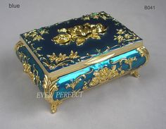 Buy directly from the world's most awesome indie brands. Or open a free online store. - Blue or peach jewelry box with gold detail with roses. Felt lined. Jewellery Boxes, Jewelry Box, Metal Jewelry, Cosmetic Box, Antique Boxes, Antique Gold, Pretty Box, Vintage Box, Small Boxes