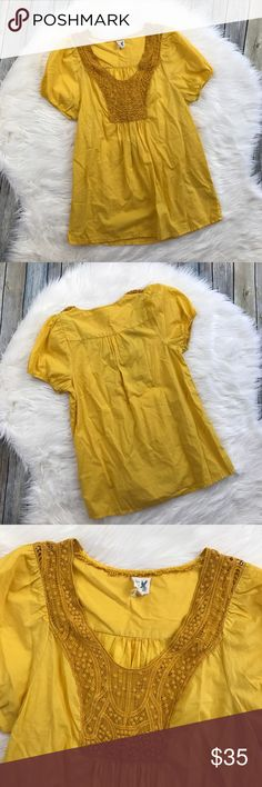 """Edme & Esyllte Anthropologie Yellow Peasant Top Super gorgeous golden yellow short sleeve top. Loose fit. Embroidered details near the chest and neckline. Gently used with no flaws. 100% cotton.  Measurements laying flat (without stretching): Armpit to armpit: 19"""" Length, shoulder to hem: 27"""" Anthropologie Tops"""