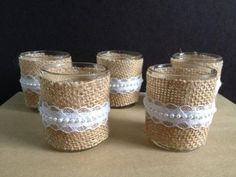 Votive candles wrapped in burlap
