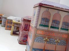 These ones got away :(  Vintage Tin Houses Historical Building Instant Collection Containers... 18.00, via Etsy.