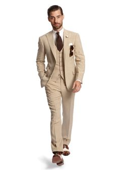 Tan suit by Ralph Lauren - not fond of the color -would love this in a tweed. But, the cut is fab.