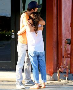 Doting dad-to-be! Ashton Kutcher embraced his pregnant fiancée Mila Kunis with a warm hug after indulging in Greek food at DarbinZ Kebab in Studio City.