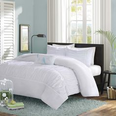 The Tatiana Duvet Cover Set creates an opulent look for your bedroom to update your current décor. The ruched fabric on the comforter and sham gives the appearance of scalloped edges and ruffles covering the bed.