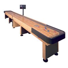 """Champion Shuffleboard is proud to present its elite line of shuffleboard tables. With state-of-the-art electronics to the finest playing field of solid maple, including our famous """"polymer finish"""" which never needs resurfacing. Demand the same finish that is insisted upon by the pros for tournament play. These features and others have made Champion the largest shuffle board manufacturer in the world. http://www.BilliardFactory.com/Champion-Shuffleboard-Table"""