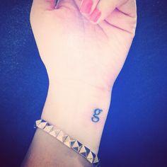 Lowercase g tattoo