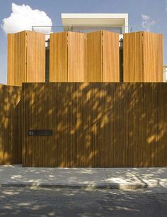 House 53 - concrete house with folded wood walls by Marcio Kogan, São Paulo, Brazil