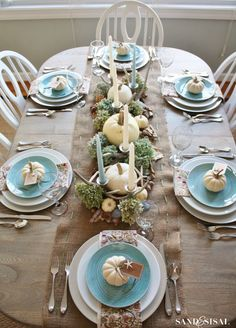 Bring a little bit of the beach to your Thanksgiving table with a stylish mix of blue and white table accents. An added beachy-bonus: the burlap table runner. Find out how to get the look at sandandsisal.com - ELLEDecor.com