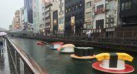 Osaka river turns into giant floating sushi train