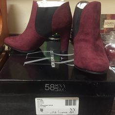 Burgundy Booties with black elastic on sides Brand new never worn, only tried on in the store. New York & Company Shoes Ankle Boots & Booties