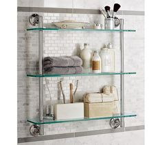Maximizes wall space by placing a floating glass shelves. Mercer Triple Glass Shelf | Pottery Barn.