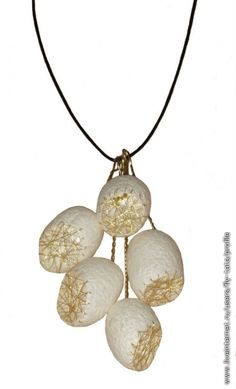 silk cocoons and stitching