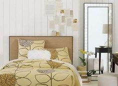 Need to redo my upholstered headboard to look like this!  Maybe burlap and nailheads?