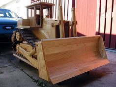 A yard full of wooden construction equipment models in large scale | Woodworking ideas