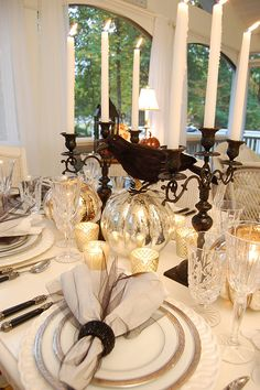 Gorgeous Halloween tablescape featuring Noritake's Crestwood Platinum and Vendome Clear stemware! Love the crow and silver pumpkins!