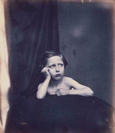 Photograph of the young Prince Arthur, bare-chested, with his head leaning on his right hand and his left arm resting on cushion in front of him.    Prince Arthur (later Duke of Connaught) was born at Buckingham Palace on 1 May 1850. He was the seventh child and third son of Queen Victoria and Prince Albert, and enjoyed a long life of distinguished military and public service.