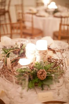 candles + pine cones Florals by : Southern Blooms