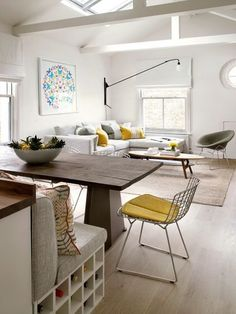Bench back onto breakfast bar or island to create back to back zoning with dining leading on to lounge.Not dining table in front of doors as on plan