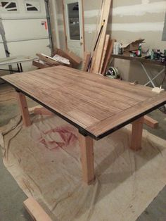 Diy Dining Table Laminate Flooring As The Table Top Within A Steel Frame