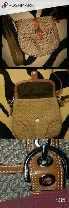 Cross body COACH purse Small sized. Best for when you need to carry a few things without a large bag. It snaps closed in the main compartment and has an extra zipper pocket at the top. Coach Bags Crossbody Bags